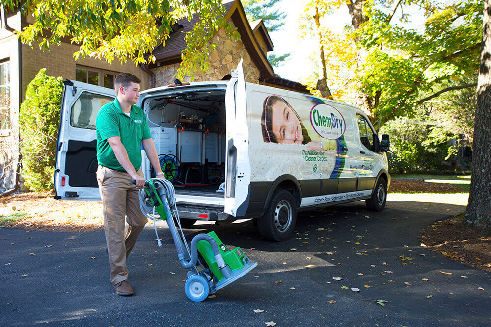 carpet cleaning tech with equipment